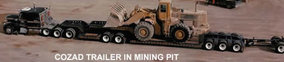 Cozad 2 x 3 x 1 booster moving Cat 988 Loader in a mining pit operation