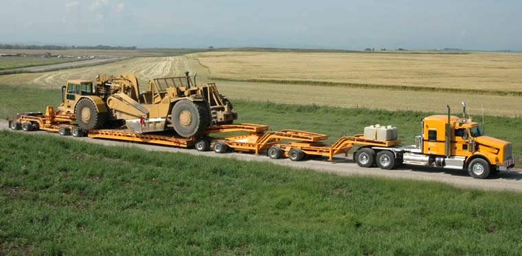 Cozad 9 axle with double 16 tire Jeep setup working in Canada